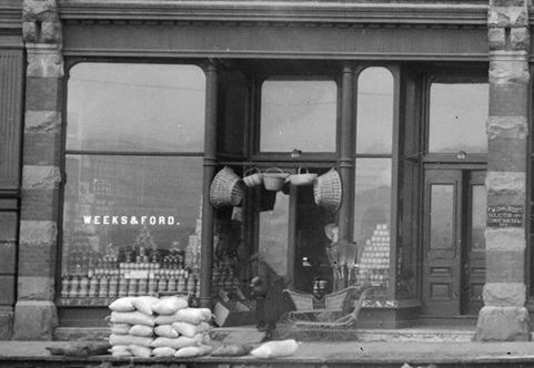 Weeks and Ford, 1890s, detail from Thompson-Ogle building; Vancouver City Archives, SGN 14 - [Businesses at 500 block of West Hastings Street]; http://searcharchives.vancouver.ca/businesses-at-500-block-of-west-hastings-street.