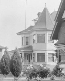 2050 Comox Street - Detail from Residences - Comox Street - Library and Archives Canada - Online MIKAN no. 3308694; http://data2.archives.ca/ap/a/a009558.jpg