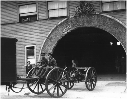 Stanley Park Armouries - City of Vancouver Archives - June 1928 - CVA 99-1682 - 5th Med Battery; http://searcharchives.vancouver.ca/5th-med-battery-outside-arena-building-on-georgia-street-2