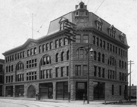 "Exterior of the MacKinnon Building - 413 Granville Street; Vancouver City Archives, AM54-S4-: Bu P260; http://searcharchives.vancouver.ca/exterior-of-mackinnon-building-413-granville-street: ""The boy on the bicycle is Arthur T. Dalton and the man in the doorway is H.H. Morris."""