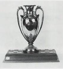 Buscombe Trophy: First Trophy of Royal Vancouver Yacht Club, 1905, Presented by Frederick & George Buscombe, For fastest boat over English Bay Course, Royal Vancouver Yacht Club, Annals, 1903-1965, page 197; http://www.royalvan.com/files/Annals_Section6_Miscellaneous.pdf.