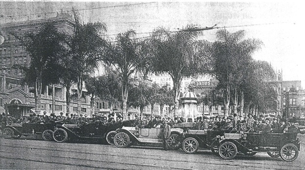 """Vancouver Sun, May 7, 1999, page E-1: """"California Dreamin': 'The Vancouverites,' a number of Vancouver residents who moved to San Diego in 1912 to buy lots during a real estate boom, are shown parked in their cars in Spreckels Square. Standing in the centre is Grant MacArthur who promoted the scheme."""""""