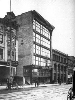 Frederick Buscombe and Company Ltd.; http://changingvancouver.wordpress.com/2013/12/13/the-brunswick-west-hastings-street/. The building later became part of the Army and Navy Store.