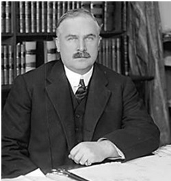 J.H. Senkler in the Pacific Building, 1915; detail, Vancouver City Archives, CVA 99-170; http://searcharchives.vancouver.ca/j-h-senkler-pacific-building-interior-man-seated-at-desk.