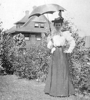 "Mrs D C McGregor - about 1898; Port P279.3 - The ""General Agent"" [Mrs. D.C. McGregor (nee Johnston) with her parasol], about 1898, http://searcharchives.vancouver.ca/general-agent"