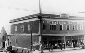 Desbrisay's Departmental Store, Mission City walking tour pamphlet, http://www.heritage-places.com/documents/2005-Walking-Tour.pdf. [This building also appears in the photograph of Main Street, above.]