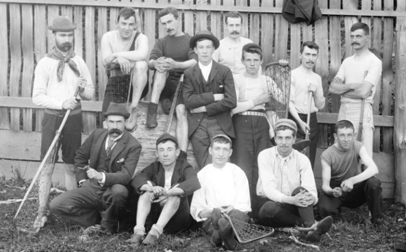 Men assembled in front of fence after lacrosse match between newspaper employees and insurance agents at Brockton Point grounds, Stanley Park; Vancouver City Archives, SGN 391; 1893, [John William Prescott is in the back row at the centre.]; http://searcharchives.vancouver.ca/men-assembled-in-front-of-fence-after-lacrosse-match-between-newspaper-employees-and-insurance-agents-at-brockton-point-grounds-stanley-park