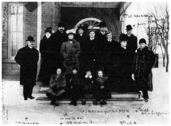 J. C. Kavanagh, Brandon's first postmaster, at left, with other Kavanagh family members, Martin Kavanagh, The Assiniboine Basin: A Social Study of Discovery, Exploration and Settlement; November 2007, reproduction of 1946 and 1967 editions; following page 182; http://www.mhs.mb.ca/docs/books/assiniboinebasin.pdf.