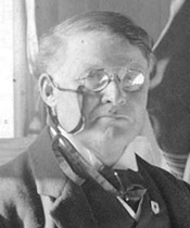 """Sir Charles [Hibbert] Tupper, about 1920, Vancouver City Archives, detail from """"A banquet for leading citizens at the Vancouver Club,"""" Port P1187; http://searcharchives.vancouver.ca/banquet-for-leading-citizens-at-vancouver-club."""