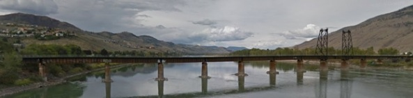Canadian National Railway bridge (built 1914) across Thompson River at Kamloops, British Columbia; Google Streets; Searched February 11, 2016; image dated September 2015.