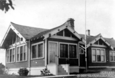 Exterior of single story house owned by Dr. Ewert, 1928; The Exploration Place, Settlers Effects; Catalogue ID: P987.13.1; http://www.settlerseffects.ca/pls/cats_web/WEB_EXHIBITIONS.show_searchimage?SearchID=24262&LANG=EN&VRN=1&TARGET=_self