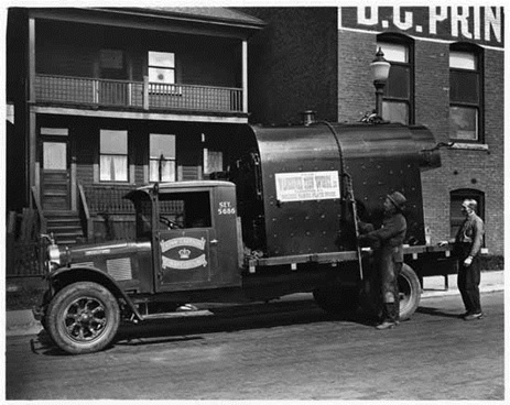 Kenworth truck used by Crown Cartage and Warehousing Company moving a boiler in the 900 block Homer; 1929, Vancouver Public Library, VPL Accession Number: 9017; http://www3.vpl.ca/spePhotos/LeonardFrankCollection/02DisplayJPGs/1680/9017.jpg [The man on the right may be John McIntosh Lorimer].
