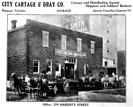 City Cartage & Dray Co., 219 Hardisty Street, Fort William, Ontario, 1913, Davidson & Smith elevator in background. Reproduced in Hot Rods and Jalopies, More Early Fort William and Port Arthur, April 21, 2010; http://hotrodsandjalopies.blogspot.ca/2010/04/more-early-fort-william-and-port-arthur.html.