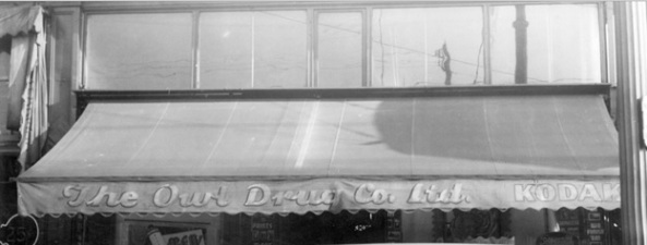 Awning for The Owl Drug Company Limited at the corner of Nelson Street and Granville Street, Oct. 26, 1943, City of Vancouver Archives; CVA 371-868; http://searcharchives.vancouver.ca/awning-for-owl-drug-company-limited-at-corner-of-nelson-street-and-granville-street.
