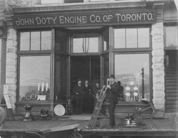 Exterior of John Doty Engine Co. of Toronto Ltd. - 520 Cordova Street, 1891; Vancouver City Archives, Bu P250, http://searcharchives.vancouver.ca/exterior-of-john-doty-engine-co-of-toronto-ltd-520-cordova-street (W.C. Ditmars is second from left in the doorway).
