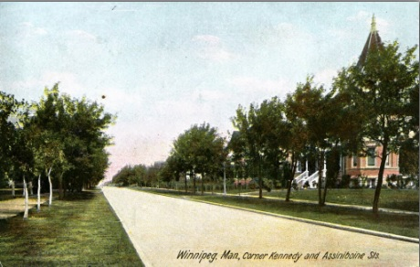 Winnipeg, Corner of Kennedy Street and Assiniboine Street, 1907, Postcard, http://saskhistoryonline.ca/islandora/object/manpostcards%3A470#page/1/mode/2up [The turreted house on the right is 11 Kennedy Street, the home of Nicholas Bawlf. Number 19 was two houses to the left, obscured by trees in this photograph.]