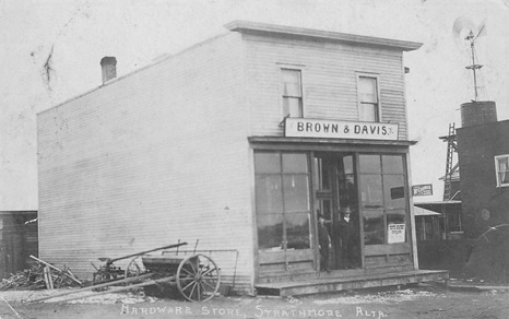Brown & Davis Hardware Store, Strathmore, Alberta; https://www.stanleygibbons.com/prd/postcards-canada-alberta-other-rp-brown-davis-hardware-store-strathmore-alberta-00/102117281 [This building later held T.H. Eves's harness and shoe repair shop (see below). W.E. Brown also built the larger building next door.]