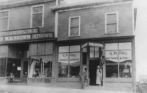 T. H. Eves' harness and shoe repair shop, Strathmore, Alberta [W. E. Brown furniture store next door]; Glenbow Museum Archives, File number: NA-2763-2.