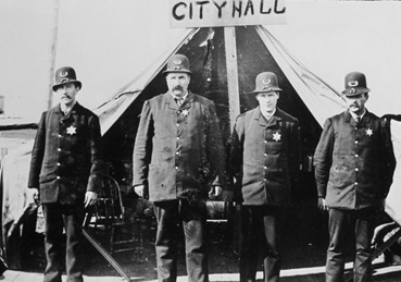 V.W. Haywood, (third from left), Vancouver City Police, September 1886; City of Vancouver Archives, 2011-010.1687; http://searcharchives.vancouver.ca/police-in-front-of-tent.