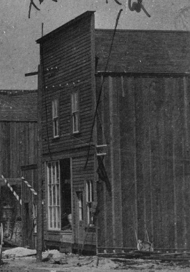 Tilley's bookstore and telephone exchange, detail from Cordova Street [looking west from Carrall Street]: July 1886 - five weeks after the fire; City of Vancouver Archives, Str P7; http://searcharchives.vancouver.ca/cordova-street-looking-west-from-carrall-street-july-1886-five-weeks-after-fire.