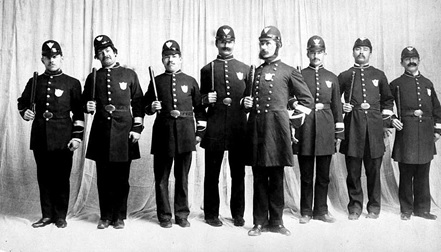 "Victoria Production of ""Pirates Of Penzance""; The Policemen Played By Ross Monro, Charles Rhodes, W.T. Williams, Percy Dickenson, Herbert Kent, Robert Johnson, W.H. Pegram, James E. [sic], April 1892; British Columbia Archives, Item A-05664; http://search.bcarchives.gov.bc.ca/victoria-production-of-pirates-of-penzance-policement-played-by-ross-monro-charles-rhodes-w-t-williams-percy-dickenson-herbert-kent-robert-johnson-w-h-pegram-james-e."