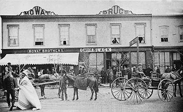 Local citizens, carriages and saddle horse in front of business block, Regina, Saskatchewan; Glenbow Archives; NA-4035-185; http://ww2.glenbow.org/dbimages/arc7/v/na-4035-185.jpg.