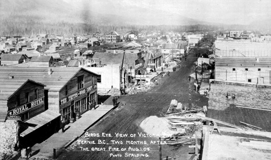 Fernie, British Columbia; Two Months after the Great Fire, 1908; photo by Spalding; Photo: B.C. Archives Call Number: A-08893; http://search-bcarchives.royalbcmuseum.bc.ca/birds-eye-view-of-victoria-avenue-fernie-bc-two-months-after-great-fire-of-august-1-1908; also available at: http://www.crowsnest.bc.ca/a_08893.html. [Temporary Trites-Wood building second from left.]
