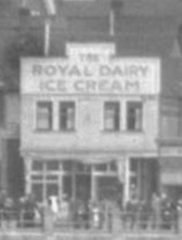 Royal Dairy Ice Cream, detail from 1200 block, east side, Denman Street – about 1919 – View of English Bay Beach and bathhouses -detail – City of Vancouver Archives – CVA 447-24; http://searcharchives.vancouver.ca/view-of-english-bay-beach-and-bathhouses-2.