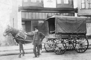 Dominion Express Company horse-drawn delivery wagon; about 1905, Vancouver City Archives; Trans P187; http://searcharchives.vancouver.ca/dominion-express-company-horse-drawn-delivery-wagon. [Unidentified Dominion Express Company employee; probably not Alfred William Lee.]