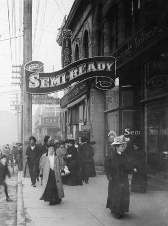 Semi-Ready Tailoring, about 1906; Vancouver City Archives, detail from Granville Street near Pender Street, looking north; CVA 677-529; https://searcharchives.vancouver.ca/granville-street-near-pender-street-looking-north-showing-sign-for-semi-ready-tailoring.