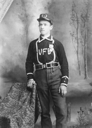 "Gabriel ""Gaby"" Thomas of the No. 2 Company, Seymour Street Fire Hall, 1889; Vancouver City Archives, Port P1118; https://searcharchives.vancouver.ca/gabriel-gaby-thomas-of-no-2-company-seymour-street-fire-hall [colour removed]."