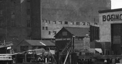 Lot 6 buildings, detail from Vancouver Rowing Club Regatta [Coal Harbour - showing arena and Boeing Aircraft Co.], May 16, 1931, Vancouver City Archives; CVA 99-2544; https://searcharchives.vancouver.ca/vancouver-rowing-club-regatta-coal-harbour-showing-arena-and-boeing-aircraft-co.