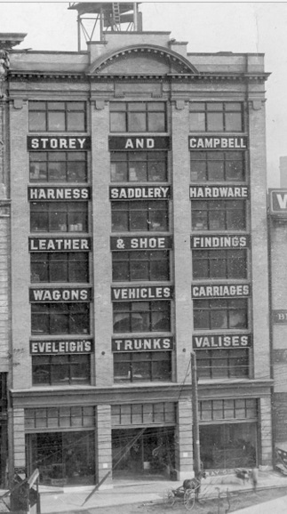 Storey and Campbell (dealers in Eveleigh's Trunks and Valises); 1912, detail from Construction of the World Building at 500 Beatty Street; Vancouver City Archives; CVA 1477-5; https://searcharchives.vancouver.ca/construction-of-world-building-at-500-beatty-street.