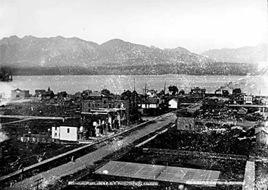 C.P.R. Park Tennis Court with homes on Howe Street and Vancouver Harbour in the background, 1889; Vancouver Public Library, VPL Accession Number: 1870; https://www3.vpl.ca/spePhotos/LeonardFrankCollection/02DisplayJPGs/162/1870.jpg.
