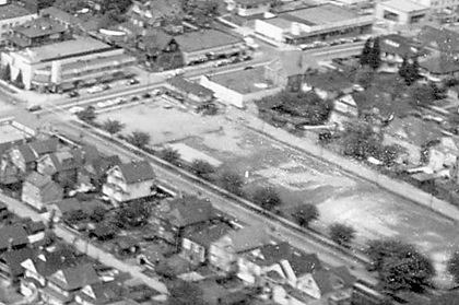 Northeast corner of Denman Street and Barclay Street, 1957, detail from Aerial view of the West End showing the increase of apartment buildings west of Cardero Street, Vancouver City Archives, Dist P133; https://searcharchives.vancouver.ca/aerial-view-of-west-end-showing-increase-of-apertment-buildings-west-of-cadero-street.