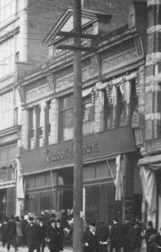 Clubb and Stewart; detail from Hastings Street between Hamilton and Homer Street, early 1900s; Vancouver City Archives; CVA 677-642; https://searcharchives.vancouver.ca/hastings-street-between-hamilton-and-homer-streets.