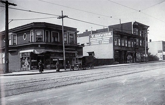 1900-block of Commercial Drive looking northwest in 1922; Vancouver Public Library, VPL 7411; https://www3.vpl.ca/spePhotos/LeonardFrankCollection/02DisplayJPGs/769/7411.jpg; also at Grandview Heritage Group; Pictorial History of Grandview; http://grandviewheritagegroup.org/?page_id=403. [In 1922, Fenyn's Grocery was operating from the ground floor.]