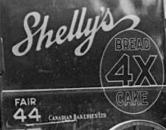 Shelly's Bread wagon, detail from Stores on Denman Street, 1928, Vancouver City Archives, Str N267.1; https://searcharchives.vancouver.ca/stores-on-denman-street.