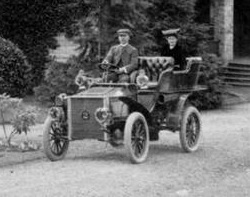 """Captain and Mrs. J.W. Troup in front of Thomas B. Hall's residence, 1910-1920, British Columbia Archives, Item C-08379 [detail]; http://search.bcarchives.gov.bc.ca/captain-and-mrs-j-w-troup-in-front-of-thomas-b-halls-residence (Number """"2"""" on radiator is the car's permit number.)"""