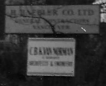 Detail from Vacant lot - Lagoon Drive and Chilco, 1968; Vancouver City Archives, AM1348 - CVA 1348-27; showing signs for H. Haebler Co. Ltd. General Contractors, Vancouver and for C.B.K. Van Norman; https://searcharchives.vancouver.ca/vacant-lot-lagoon-drive-and-chilco-house-is-rear-of-2003-haro.