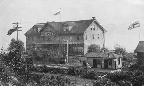 E.H. Heaps & Co. Building and Ruskin Station, post card, September 1, 1909; http://digital.lib.sfu.ca/pfp-5606/eh-heaps-co-building-and-ruskin-station-no-caption; http://digital.lib.sfu.ca/pfp-5604/msc130-14939-01.