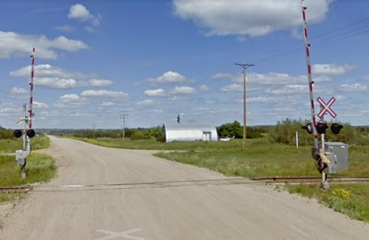 Railway crossing, Winter, Saskatchewan ; Google Streets; searched November 20, 2018; image dated July 2009 [lights and barriers would not have been there in 1922].