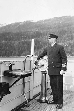 Captain Duncan Mackenzie aboard the SS Prince Rupert, 1918; British Columbia Archives; Item C-00594; https://search-bcarchives.royalbcmuseum.bc.ca/captain-duncan-mackenzie-aboard-ss-prince-rupert.