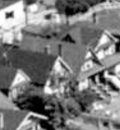 1943 Comox Street, 1962; detail from West End from the air; Vancouver City Archives, 1962; Air P96; https://searcharchives.vancouver.ca/west-end-from-air.