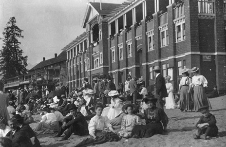 A crowd on the beach in front of the English Bay bathhouse, about 1910 [sic]; Vancouver City Archives, CVA 1376-80.32; https://searcharchives.vancouver.ca/crowd-on-beach-in-front-of-english-bay-bathhouse.