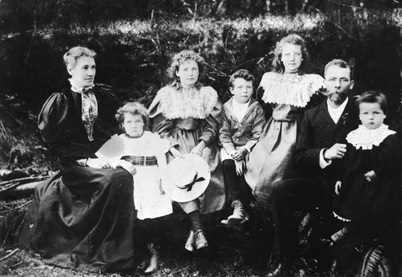 Portrait of the A.B. Sayer Smith family. Pictured (L-R): Mother, Pauline, Dora, Robert, Maud, Father (A.B. Sayer Smith) and Alexander, 1896; Vancouver City Archives, CVA 192-3; https://searcharchives.vancouver.ca/portrait-of-b-sayer-smith-family.
